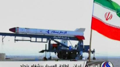 An image grab taken from Iran's Al-Alam TV on January 28, 2013, shows the Iranian flag at an unknown location flying in front of a capsule containing a live monkey which the Tehran-based Arab-language channel said they sent up into space and later retrieved intact (AFP Photo)