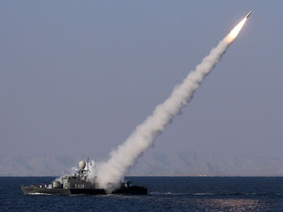"Iranian navy fires a Mehrab missile during the ""Velayat-90"" naval wargames in the Strait of Hormuz in southern Iran on January 1, 2012.(AFP Photo / Ebrahim Noroozi)"