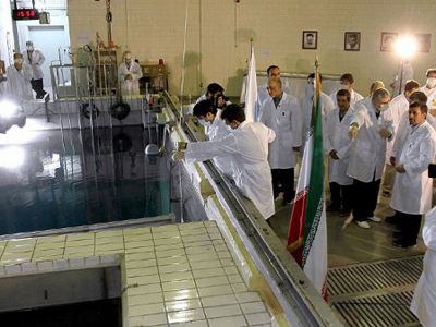 A handout picture released by Iranian President Mahmoud Ahmadinejad's official website shows him (R) listening to an expert during a tour of Tehran's research reactor centre (AFP Photo / Iranian Presidency)