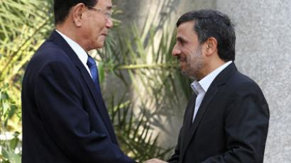 ranian President Mahmoud Ahmadinejad (R) shakes hands with North Korea's ceremonial head of state, Kim Yong-Nam in Tehran on September 1, 2012. (AFP Photo/Atta Kenare)
