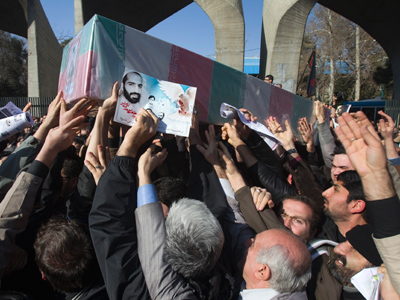 Iranian worshippers carry a picture and coffin of Iranian nuclear scientist Mostafa Ahmadi-Roshan, who was killed in a bomb blast in Tehran on January 11, during his funeral after Friday prayers in Tehran January 13, 2012 (Reuters/Morteza Nikoubazl)