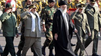 "Iran's supreme leader Ayatollah Ali Khamenei (C) during a visit to a Tehran military college on November 10, 2011 where he said that Iran ""will respond with full force"" to any attack – or even any threat of military action (AFP Photo / Leaderir)"