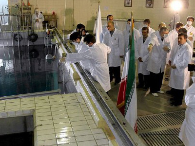 Tehran: A handout picture released by Iranian President Mahmoud Ahmadinejad's official website shows him (R) listening to an expert during a tour of Tehran's research reactor centre on February 15, 2012. (AFP Photo/Ho)