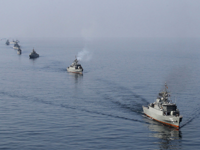 Iranian naval ships take part in a naval parade on the last day of the Velayat-90 war game in the Sea of Oman near the Strait of Hormuz in southern Iran January 3, 2012 (Reuters / Jamejamonline / Ebrahim Norouzi)