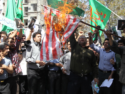 Iranian demonstrators burn the US flag during a protest against a film mocking Islam, on September 13, 2012 near the Swiss embassy in Tehran (AFP Photo / Atta Kenare)