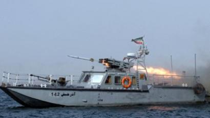 "An Iranian war-boat fires a missile during the ""Velayat-90"" navy exercises in the Strait of Hormuz in southern Iran (AFP Photo / ALI MOHAMMADI)"