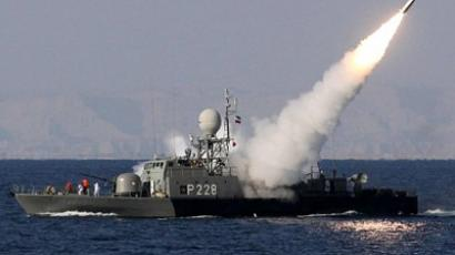 "Iranian navy fires a Mehrab missile during the ""Velayat-90"" naval wargames in the Strait of Hormuz in southern Iran on January 1, 2012 (AFP Photo / EBRAHIM NOROOZI)"
