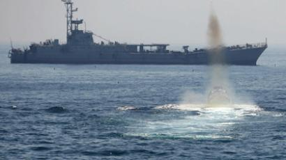 An Iranian Revolutionary Guard fast test fires towards a naval vessel (AFP Photo / Mehdi Marizad)