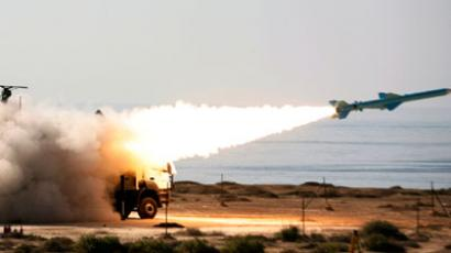 Iranian 200-kilometre (120-mile) range Qader (Ghader) ground-to-sea missile is launched on the last day of navy war games near the Strait of Hormuz in southern Iran.(AFP Photo / Jamejamonline/Ebrahim Noroozi)