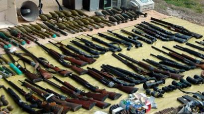 A handout picture released by the official Syrian Arab News Agency (SANA ) shows hunting rifles, computers, RPG rockets, motors shells, magazines, binoculars and riot guns displayed alongside other weapons siezed by Syrian security forces in the district of Homs. (AFP Photo / HO / SANA)