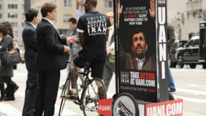 Sign protesting Iran President Mahmoud Ahmadinejad. (AFP Photo/Stan Honda)
