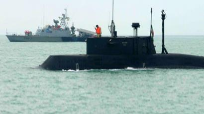 An Iranian submarine and warship take part in naval manoeuvres in the Persian Gulf (Reuters/IRNA)