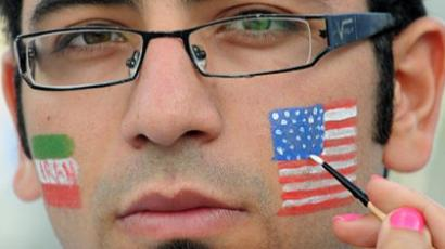 An Iranian man gets an American flag painted on his face (AFP Photo / MUSTAFA OZER)