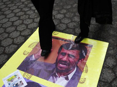 New York : Demonstrators walk on a poster of Iranian President Mahmoud Ahmadinejad during a protest. (Photo/Emmanuel Dunand )
