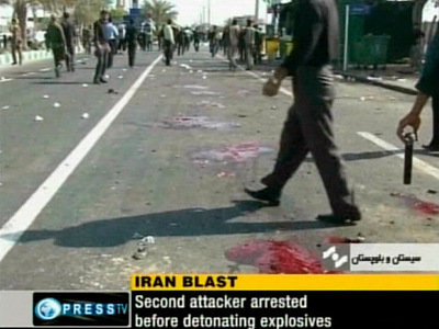 The aftermath of an explosion outside a mosque in Iran's southeastern city of Chabahr is seen in this still image taken from video December 15, 2010 (Reuters / Press TV via Reuters TV)