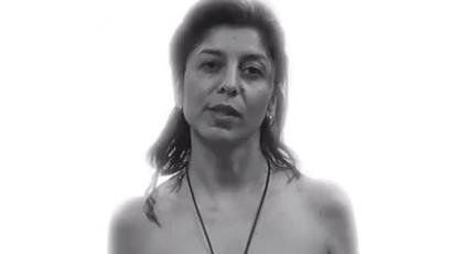 """My nudity is a 'no' to political Islam,"" says an Iranian activist while posing topless to the camera (Freeze-frame from youtube.com)"