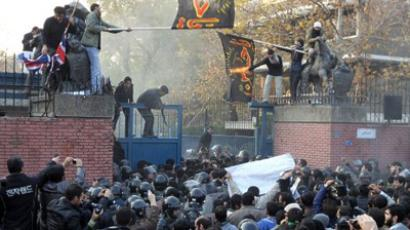 Iran, Tehran: Iranian protesters gather outside the British embassy as some break into it and bring down the British flag (L) in Tehran on November 29, 2011  (AFP Photo / Atta Kenare)