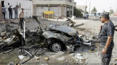 Security personnel inspect the site of a car bomb attack in Kirkuk, 250 km (155 miles) north of Baghdad, August 16, 2012.  (Reuters/Ako Rasheed)