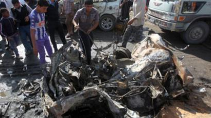 Iraqis inspect the site of a car bomb attack in Baghdad's impoverished district of Sadr City on February 17, 2013.(AFP Photo / Ahmad Al-Rubaye)