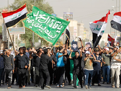 Demonstrators calling for press freedom in Baghdad (Reuters / Mohammed Ameen)