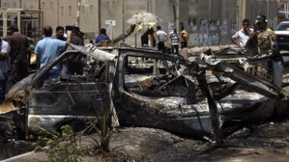 Residents gather at the site of a car bomb attack in Sadr City, northeastern Baghdad July 23, 2012. (Reuters/Stringer)