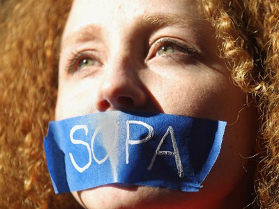 Protester Nadine Wolf demonstrates against the proposed Stop Online Piracy Act (SOPA) (Mario Tama /Getty Images / AFP)