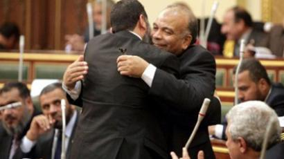 Egyptian Muslim Brotherhood member of parliament Saad al-Katatni greets another MP during parliament's first session (AFP Photo / Asmaa Waguih / Pool)
