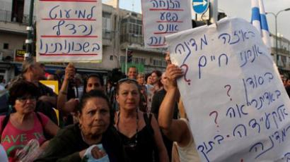 Hundreds of people demonstrate in the impoverished Hatikva neighborhood of the southern Mediterranean city of Tel Aviv on May 23, 2012 (AFP Photo / Roni Schutzer)Israel Out)