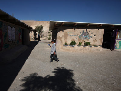 A Palestinian school girl walks outside her classroom at a Bedouin camp in the Israeli-occupied West Bank near Jericho.(AFP Photo / Abbas Momani)
