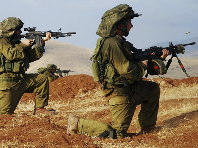 Israeli soldiers fire their weapons during a training session near Beqa'ot in the West Bank (Reuters/Handout)