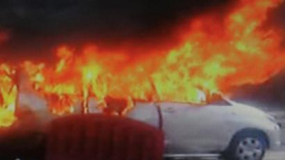 In this television frame grab taken from NDTV, the burning wreckage of an Israeli embassy car is seen following an explosion in New Delhi on February 13, 2012 (AFP Photo / NDTV)