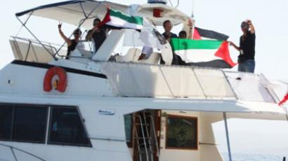 "Activists show Palestinian flags onboard a ship flying the French flag named ""Dignité - Al Karama"" (Dignity - Al Karama)  (AFP Photo / Getty Images)"
