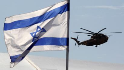 An Israeli air force helicopter, part of an air convoy carrying Israeli soldier Gilad Shalit, arrives at Tel Nof air base in central Israel (Reuters/Eric Gaillard)