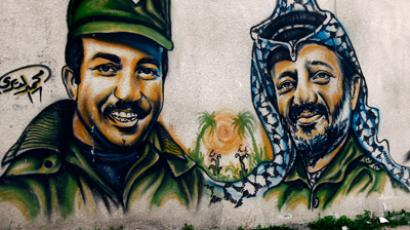 Portraits of Khalil Al Wazir (L) and Yassir Arafat (Reuters / Yannis Behrakis)