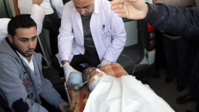 Palestinians wheel a man into hospital in Beit Hanun, after he was wounded in an Israeli air strike on northern Gaza on January 18 , 2012, in which at least one person was killed (AFP Photo / SAID KHATIB)