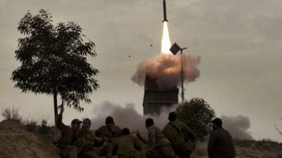 Israeli soldiers watch as a missile is launched from the Iron Dome defence system in the southern Israeli city of Beer Sheva on March 12, 2012 (AFP Photo / Topshots / Menahem Kahana)