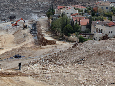 Construction goes on in the Isareli settlement of Pizgat Zeev, in the northern area of east Jerusalem (AFP Photo/Ahmad Gharabli)