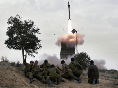 Israeli soldiers watch as a missile is launched from the Iron Dome defence system in the southern Israeli city of Beer Sheva (Menahem Kahana)