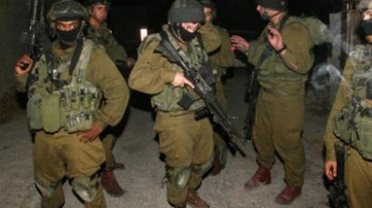 Israeli soldiers take part in a military operation searching for Hamas members overnight in the West Bank city of Hebron (AFP Photo / Hazem Bader)