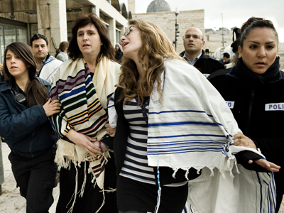 Israeli police arrest American Rabbi Susan Silverman (L), sister of comedian Sarah Silverman, and her teenage daughter Hallel Abramowitz (C), after performing Rosh Hodesh prayers at the Western Wall in Jerusalem, on February 11, 2013 (AFP Photo / Janos Chiala)