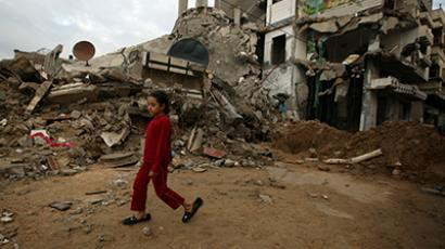 A Palestinian girl walks in the rubble of a house in Gaza City on November 27, 2012. (AFP Photo / Patrick Baz)