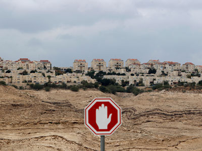 A stop sign is seen outside the West Bank Jewish settlement of Maale Adumim near Jerusalem.(Reuters / Ammar Awad)