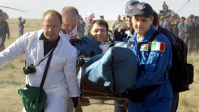 Russian space agency rescue team helps Italian astronaut Paolo Nespoli from the Russian capsule after its landing about 150 km south-east of the Kazakh town of Dzhezkazgan on May 24, 2011 (AFP Photo / Pool)