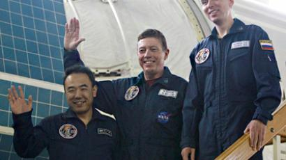 Russian cosmonaut Sergey Volkov, NASA astronaut Michael Fossum and Japanese astronaut Satoshi Furukawa (right to left) before the training on a mockup of the Russian segment on the ISS in the Cosmonaut Training Center in Star City (RIA Novosti / STF)