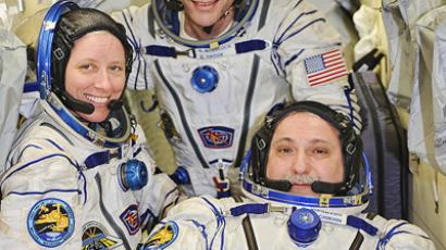 From left to right: Shannon Walker (Expedition 25 flight engineer), Doug Wheelock (commander), and Fyodor Yurchikhin (flight engineer) in the Russian MRM-1 module aboard the ISS. (Image from nasa.gov)