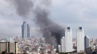 Photo taken on July 17, 2012 shows dark clouds of smoke billowing over the Besiktas district of Istanbul, after a fire broke out at a 42-storey building on July 17, 2012. (AFP Photo/Saygin Serdaroglu) Youtube video courtesy of Tuba Alioglu