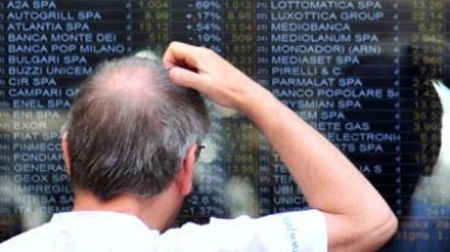 A man looking at a board outside Milan's stock exchange on July 11, 2011 (AFP Photo / Giuseppe Cacace)