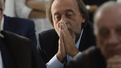 One of the indicted, Bernardo De Bernardinis, who was in 2009 deputy chief of Italy's Civil Protection Department, reacts during a session of the court in charge of the trial of six Italian scientists and a government official charged with manslaughter for underestimating the risks of a killer earthquake in 2009.(AFP Photo/Filippo Monteforte)