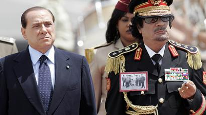 Silvio Berlusconi (L) and Muammar Gaddafi