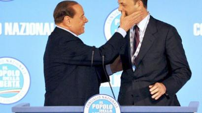 Italy, Rome: Italy's Justice Minister and new general secretary of the ruling party Partita della Liberta  Angelino Alfano is greeted by Italian Prime Minister Silvio Berlusconi during a meeting of the PDL on July 1, 2011 (AFP Photo / Alberto Pizzoli)
